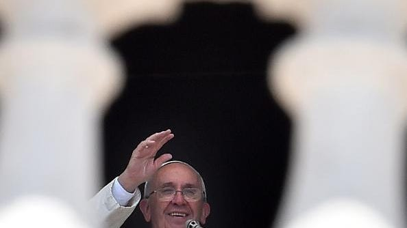 Pope Francis addresses the congregation from the window of the Apostolic Palace overlooking St. Peter's square during his Sunday Angelus prayer at the Vatican on July 19, 2015 at the Vatican. AFP PHOTO / GABRIEL BOUYS (Photo credit should read GABRIEL BOUYS/AFP/Getty Images)
