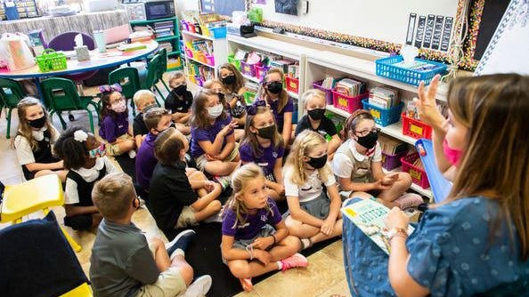 Students listen to second-grade teacher Emily Wingard during the first day of school at Prattville Christian Academy in Prattville, Ala., on Tuesday, Aug. 11, 2020. (Jake Crandall/Montgomery Advertiser}