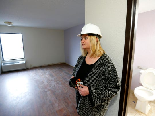 Esther Munch, Harmony House's director of marketing, stands in a room at the currently under renovation future home of Harmony House on Wednesday, December 28, 2016.