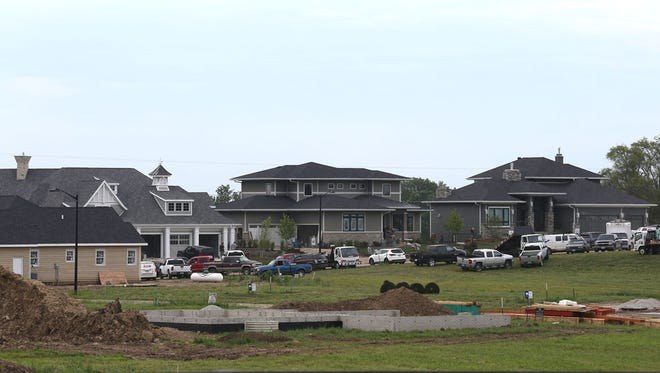 New home construction is on the rise in Norwalk, which offers a close commute and views of the Des Moines metro. Builders are busy prepping homes at The Ridge at Echo Valley in Norwalk for the upcoming Home Show Expo Monday, July 7, 2014.