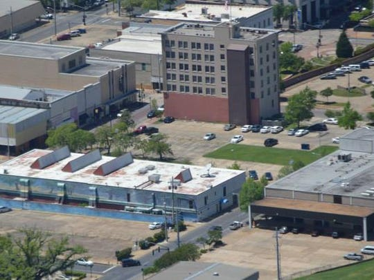 The former Town Talk press building (bottom right of photo) is located along the Red River levee in downtown Alexandria. It has been proposed in the RADD plan as the site for a multi-level, mixed-use building. The city of Alexandria has not committed to implementing the RADD plan.