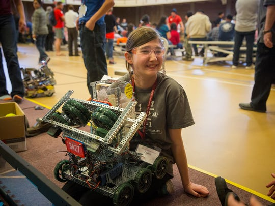 14-year-old Catriona Omdahl sits with a robot moments before entering it into battle during the New Mexico State University VEX Robotics State Championship at the campus' James B. Delamater Activity Center.