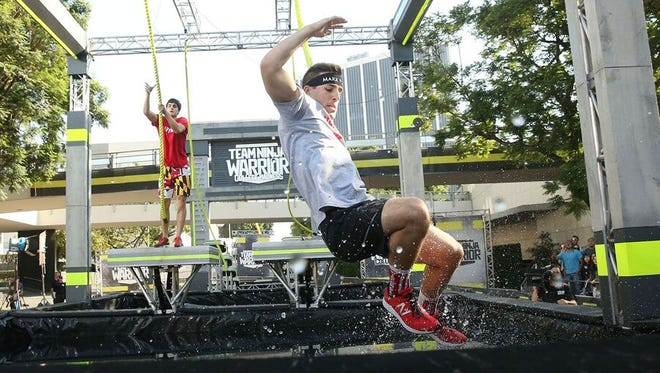 "Freedom native Andrew Philibeck competes on ""Team Ninja Warrior: College Madness"" in Los Angeles in August. The episode featuring the UW-Madison team airs Tuesday on Esquire Network."