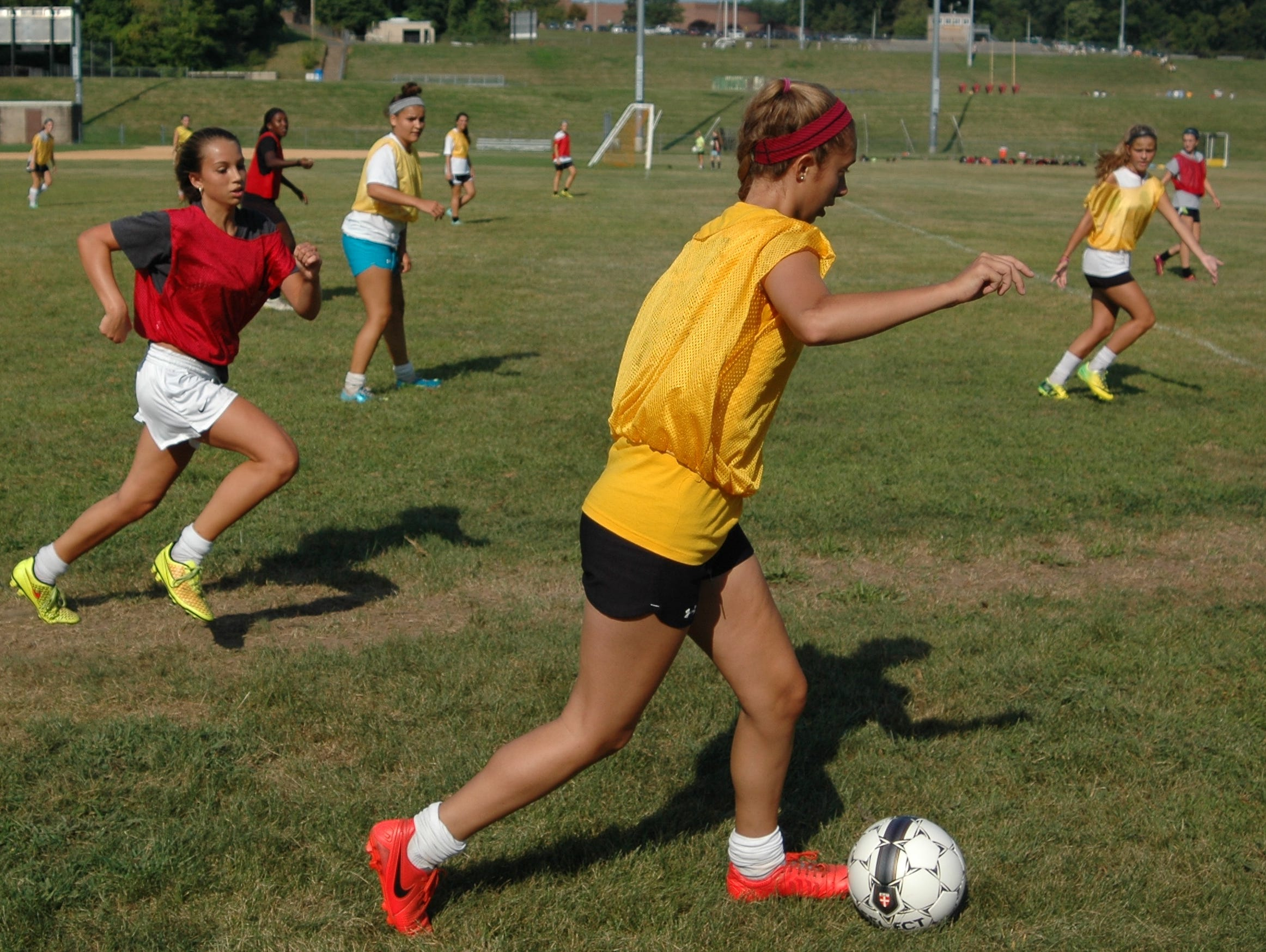 Members of Clarkstown South's girls soccer team scrimmage during a pre-season practice session at Clarkstown South High School on Auguest 25, 2015.