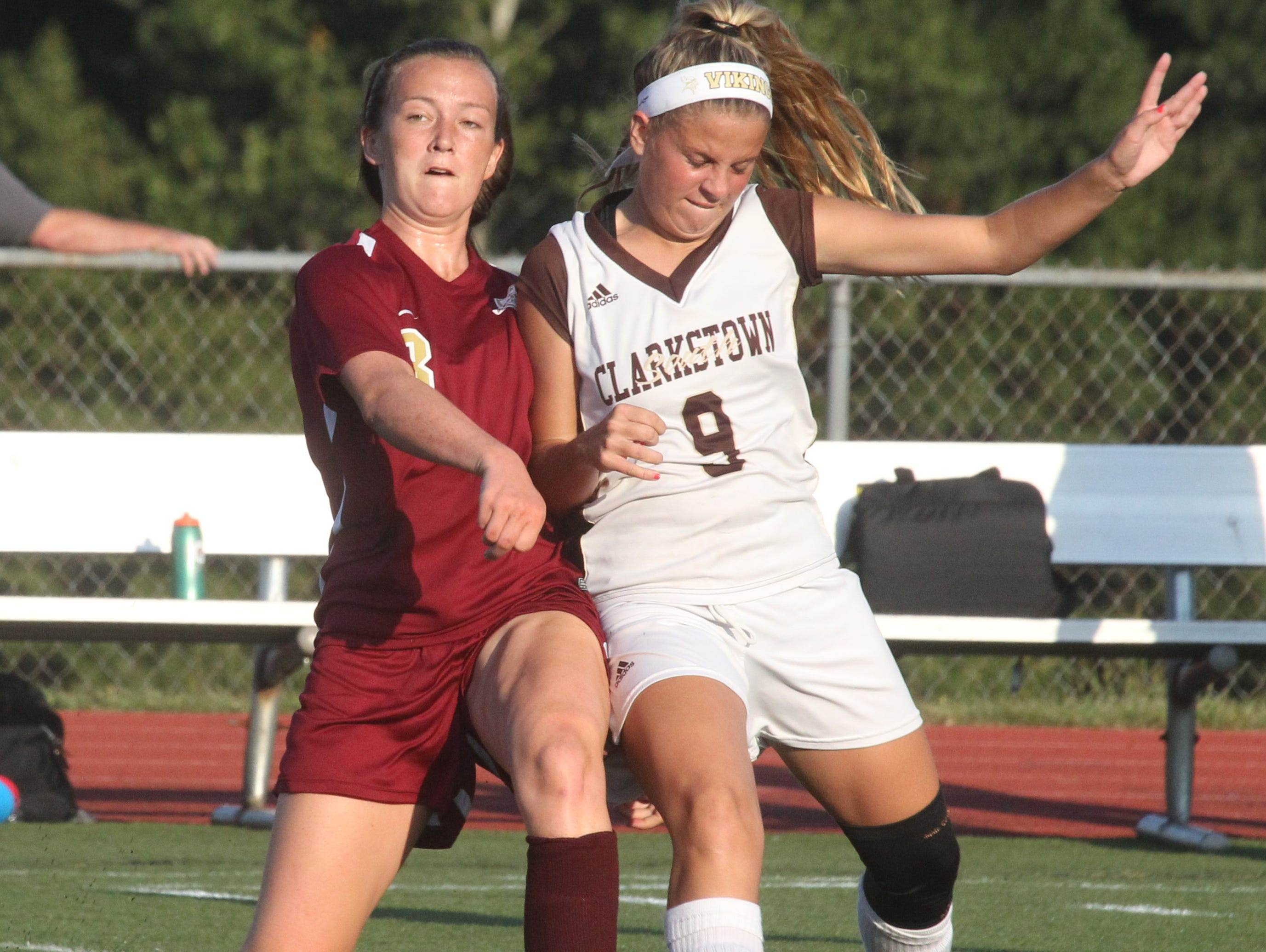 Arlington's Emma Sbrollini, left, fights for the ball with Clarkstown South's Abby Montera during their game at Clarkstown South on Tuesday.