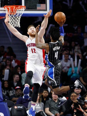 Magic guard Elfrid Payton (4) shoots as Pistons center Aron Baynes (12) defends during the fourth quarter Wednesday at the Palace.