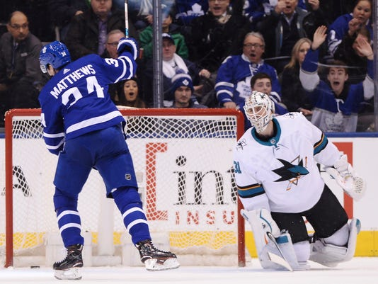 Toronto Maple Leafs center Auston Matthews (34) celebrates his goal on San Jose Sharks goaltender Martin Jones (31) during the first period of an NHL hockey game Thursday, Jan. 4, 2018, in Toronto. (Frank Gunn/The Canadian Press via AP)