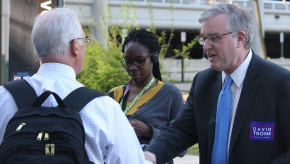 Democrat David Trone greets commuters in Derwood, Md.