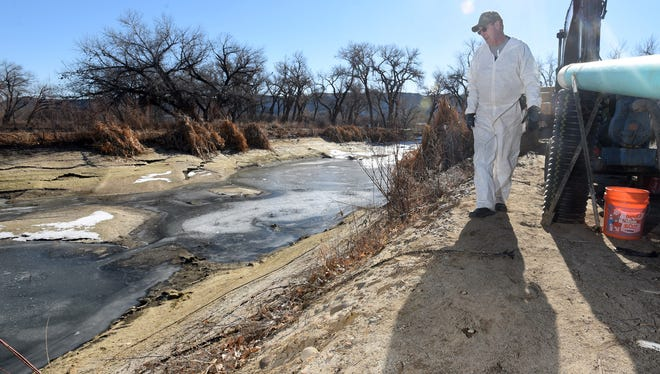 Tom Schilz, president of the Lower Valley Mutual Domestic Wastewater Association, talks about the construction of the septic pump facility that has taken the place of the Kirtland sewage lagoon on Thursday  in Kirtland.