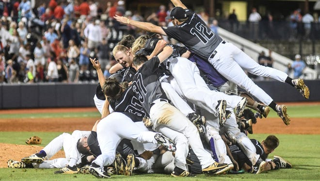 Tennessee Tech celebrates their 3-2 win over Mississippi in the NCAA Oxford Regional championship college baseball game, at Oxford-University Stadium in Oxford, Miss. on Monday, June 4, 2018. (Bruce Newman/The Oxford Eagle via AP)