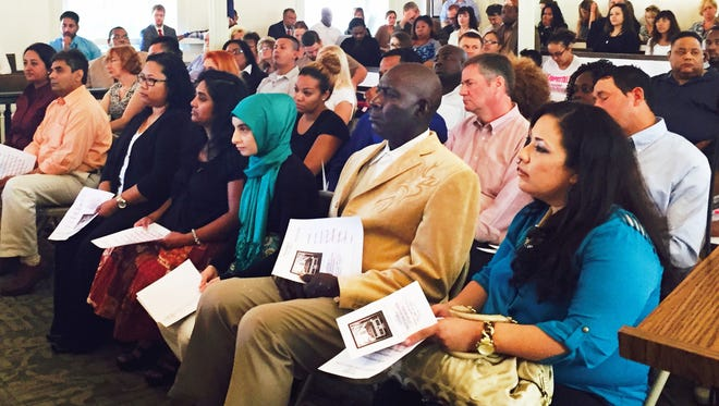 Twenty-six immigrants becme U.S. citizens at a naturalization ceremony Friday at the Olde Courthouse of Burlington County in Mount Holly. They hail from 18 countries