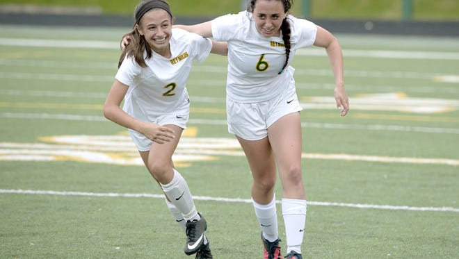 Reynolds' Pali Smith, left, and Karissa Grooms