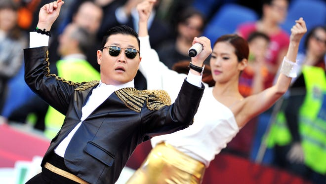 Korean pop artist Park Jae Sang, popularly known as 'Psy', sings as he performs his 'Gangnam Style' song prior to the Italian Cup football final at Rome's Olympic stadium on May 26, 2013.