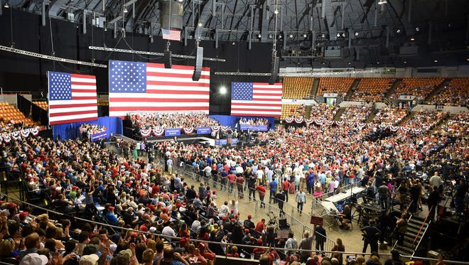 President Donald Trump's supporters listen to musician Trace Adkins prior to the start of rally for U.S. Rep. Marsha Blackburn held at Municipal Auditorium, Tuesday, May 29, 2018, in Nashville, Tenn.