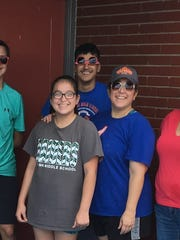 The Game Recyclers crew of (from left) Eric Diaz, Faucher,  Laila Leyva & Enrique Leyva with their mother Monica Leyva,  and Stacy Combs