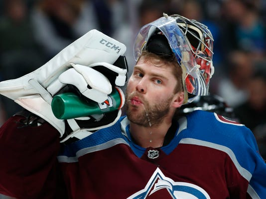Colorado Avalanche goaltender Semyon Varlamov takes a drink during a timeout in the team's NHL hockey game against the Nashville Predators, during the second period Friday, March 16, 2018, in Denver. (AP Photo/David Zalubowski)