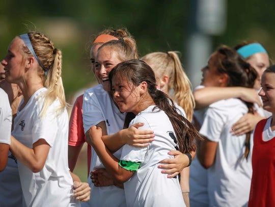 Members of the Ankeny Centennial girls soccer team