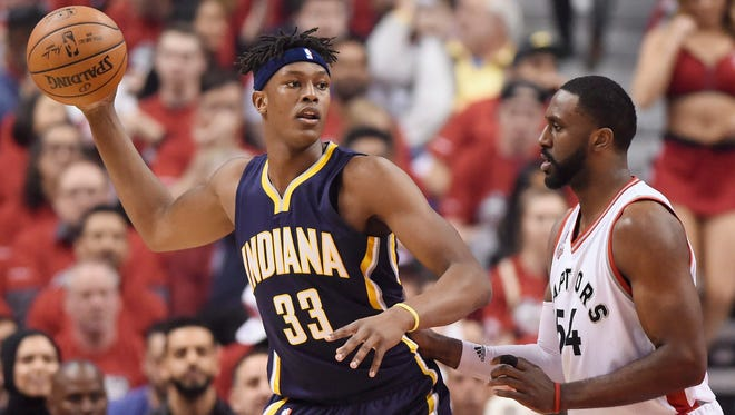 Indiana Pacers forward Myles Turner, left, looks to pass as Toronto Raptors forward Patrick Patterson defends during the first half of Game 7 of round one NBA playoff basketball action in Toronto on Sunday, May 1, 2016. (Frank Gunn/The Canadian Press via AP)