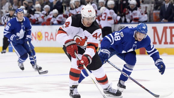 Devils left wing Miles Wood (44) steals the puck from Toronto Maple Leafs defenseman Calle Rosen (48) to score on a breakaway during the first period of a game Wednesday, Oct. 11, 2017, in Toronto.