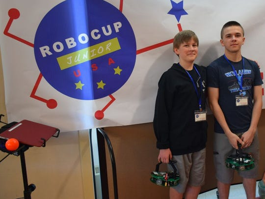Alexander and Nicholas Kmosko, ages 14 and 13, of Flemington, won the RoboCupJr USA Soccer Championship held at the Horace Mann School on May 21.