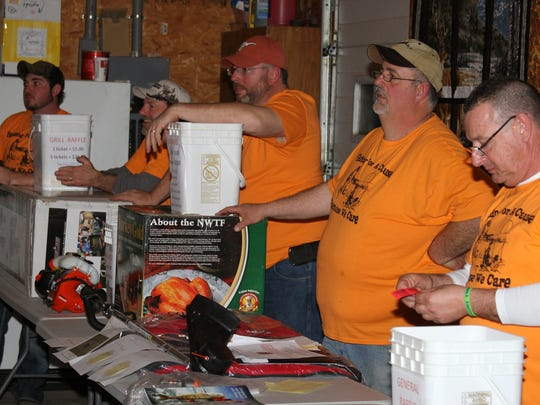 Members of the Poweshiek County Ice Fishing Club get ready to start the raffle at the 8th Annual fishing Tournament Fundraiser and Fish Fry.
