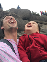Near the top, Dean Overlin and his son, Jaylen, celebrate the wonder.