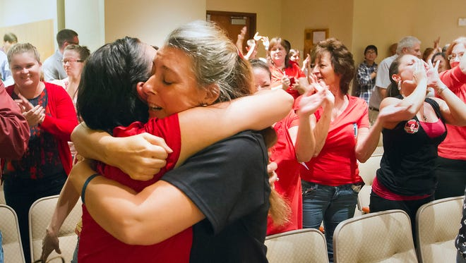 Rita Giddens, left, and Tess Brennan celebrate the Lee County School Board opting out of Common Core testing Wednesday, Aug. 27, 2014, during a school board meeting in Fort Myers, Fla.