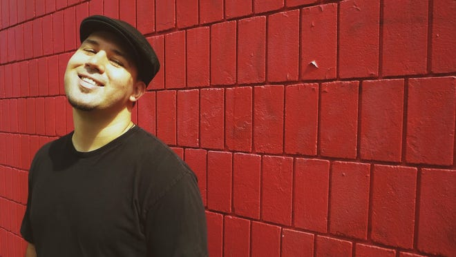 Guante, a slam poet, will perform at Tuesday's eighth annual Voices of Men breakfast in downtown Appleton.