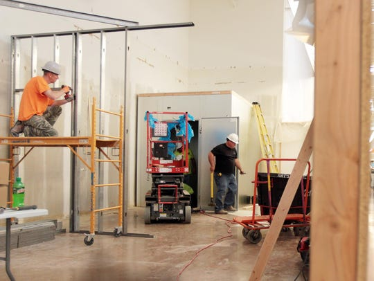 Carpenter Scott Brinkman installs a metal stud wall