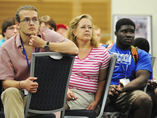 Eric Owings, left, who is transferring from Nashville State to MTSU, listens during a special orientation for transfer students June 23 on campus in Murfreesboro.