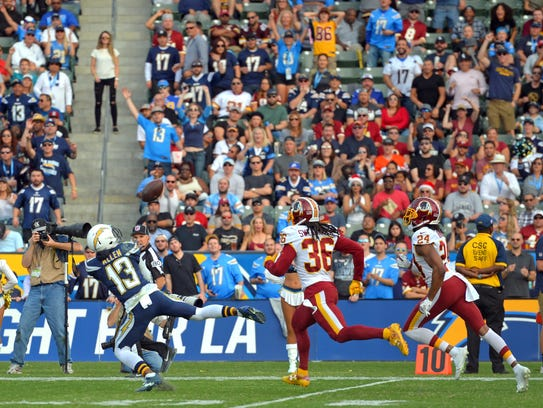 Chargers receiver Keenan Allen (13) catches a pass