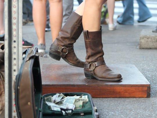 Hillary Klug buck dances on Broadway in Nashville.