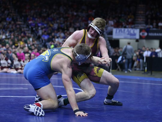 Wahlert's Kolton Bartow wrestles PCM's Lucas Roland during the championship round of the class 2A Iowa high school state wrestling tournament on Saturday, Feb. 17, 2018, in Wells Fargo Arena.