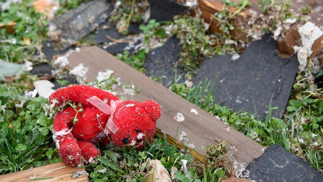 A teddy bear lies among the debris Sunday morning after a fierce storm hit Saturday, Feb. 24, 2018, in the Farmington subdivision in Clarksville, Tenn.