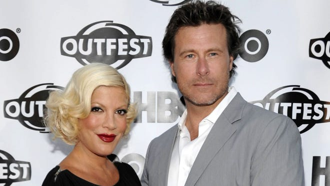 """FILE - In this July 7, 2011 file photo, actress Tori Spelling, left, and actor Dean McDermott arrive at the premiere of the feature film """"Gun Hill Road"""" in Los Angeles.  McDermott has entered rehab for an unspecified treatment, his publicist Jill Fritzo confirms. In a statement to People, who first reported the story, McDermott says, ìI am truly sorry for the mistakes I have made and for the pain Iíve caused my family.î He goes on to say heís being treated for ìsome health and personal issues.î Forty-seven year old McDermott and 40-year-old Spelling were married in 2006 after meeting on the set of a TV movie in Canada. (AP Photo/Dan Steinberg, File) ORG XMIT: NYET427"""