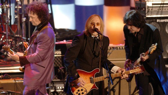 Tom Petty (center) and The Heartbreakers perform after being inducted into the Rock and Roll Hall of Fame in March 2002 at New York's Waldorf Astoria.