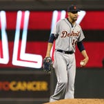 Detroit Tigers pitcher David Price gives up a walk to Minnesota Twins'  Aaron Hicks in the fourth inning of a baseball game, Wednesday, Sept. 17, 2014, in Minneapolis.