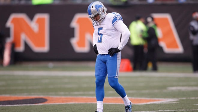 Lions kicker Matt Prater (5) walks back to the bench after missing a 50-yard field goal during the second half on Sunday, Dec. 24, 2017, in Cincinnati.