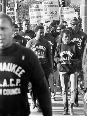 Members of the Youth Council of the Milwaukee chapter of the NAACP march down a south side street on Sept. 8, 1967. This photo was in the Sept. 11, 1967, Milwaukee Journal.