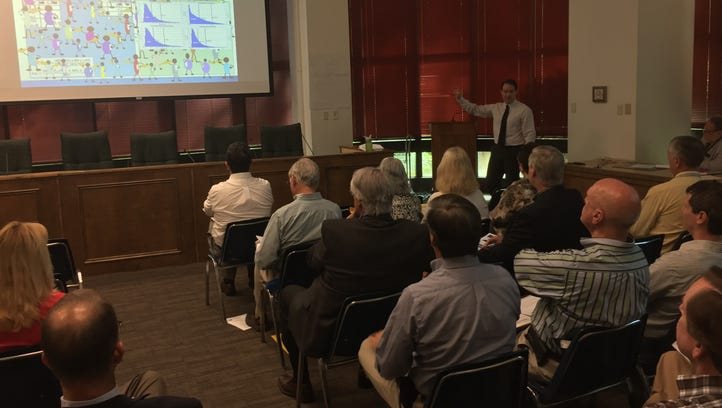 DEP officials unveil proposed new criteria for toxins in surface waters during a workshop in May in Tallahassee.