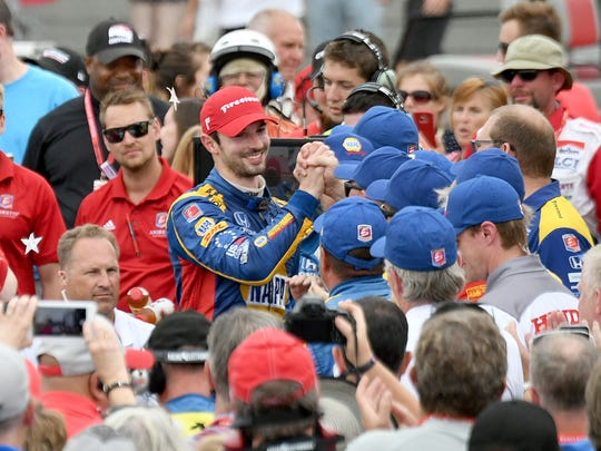 Alexander Rossi accepts congatulations from the team after winning the Honda Indy 200 at the Mid-Ohio Sports Car Course.