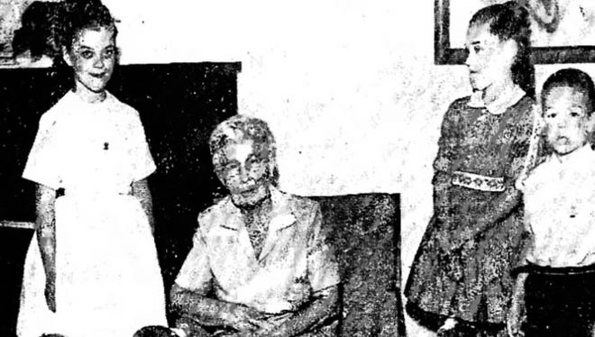 Mrs. Callie Fairley is pictured with her great-grandchildren. From front left are 3-year-old twins Amy and Ann Stowe, 1½-year-old Cynthia Stowe and 3-year-old Kathryn Korniloff. At rear with Fairley are Lydia Korniloff, 9 years old, Linda Stowe, also 9, and Paul Korniloff, 5. The Mother of the Year's other great-grandchild is Carl J. Fisher, 23, who was serving with the U.S. Marine Corps.