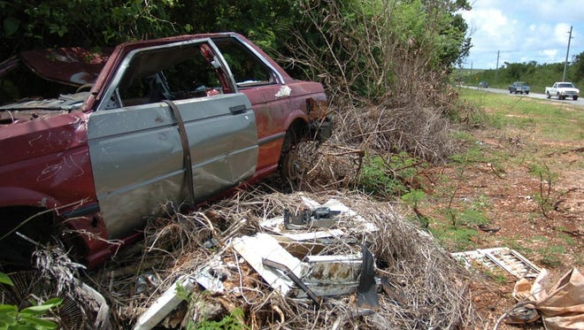 A junk car is shown in this file photo. No junk vehicles are allowed to be dumped on government easements or you will be cited and reported to EPA.