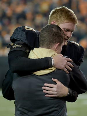 Vanderbilt long snapper Jacob Schultz (48) is surprised on Senior Night by his brother, Navy Ensign Josh Schultz, who returned from Iraq before the game against Tennessee at Vanderbilt Stadium Saturday, Nov. 26, 2016, in Nashville, Tenn.