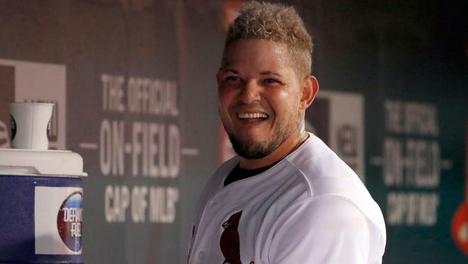 St. Louis Cardinals' Yadier Molina smiles in the dugout after hitting a solo home run during the sixth inning of a baseball game against the San Diego Padres Tuesday, Aug. 22, 2017, in St. Louis. (AP Photo/Jeff Roberson)