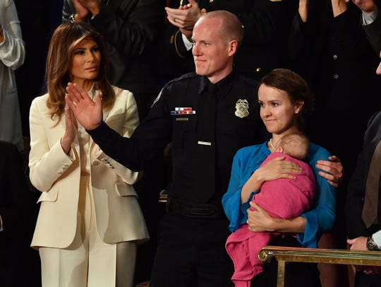 Police Officer Ryan Holets, his wife, Rebecca, and
