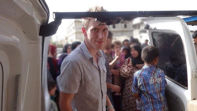 Abdul-Rahman (Peter) Kassig is shown in front of a truck somewhere along the Syrian border between late 2012 and autumn 2013 as Special Emergency Response and Assistance (SERA) was delivering supplies to refugees before the American aid worker was held captive by Islamic State jihadists.
