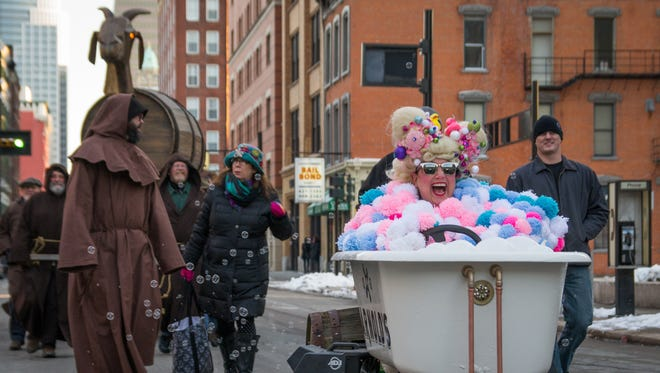 Pam Kravetz drives a bathtub for Arnold's Bar and Grill during the 2015 Bockfest parade.