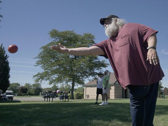 Ed Frazier plays bocce ball in the Canton Senior Games.