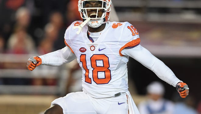 Clemson safety Jadar Johnson (18) celebrates after the Tigers stopped Boston College on the goal line during the 2nd quarter at Boston College's Alumni Stadium in Chestnut Hill, Massachusetts on Friday.